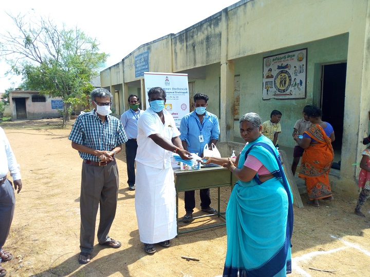Panchayat president distributing mask